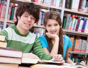 smart-young-man-and-woman-near-shelves-of-books